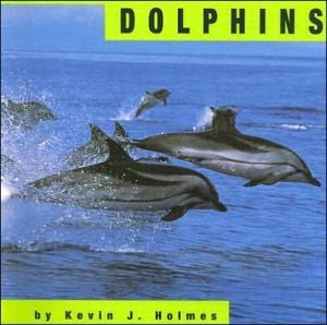 Dolphins book written by Kevin J. Holmes