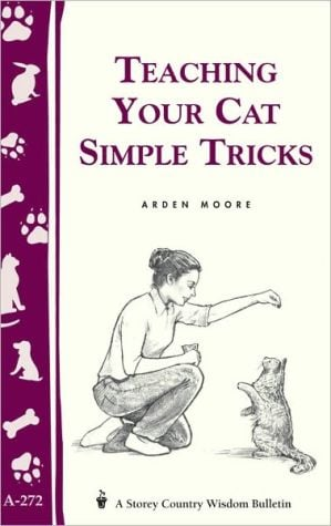 Teaching Your Cat Simple Tricks book written by Arden Moore